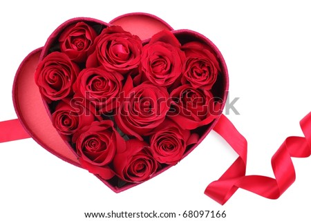 Rose petals in heart-shaped box on white background - stock photo