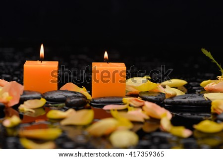 rose petals with candle and therapy stones , - stock photo