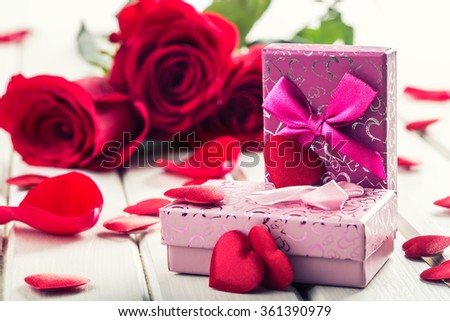 Rose. Red roses.  Bouquet of red roses. Several roses on Granite background. Valentines Day, wedding day background - border. Rose petals and hearts Valentine gift boxes. Waters drops on roses petals. - stock photo