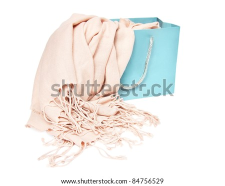 Rose scarf in shopping bag isolated on a white background - stock photo