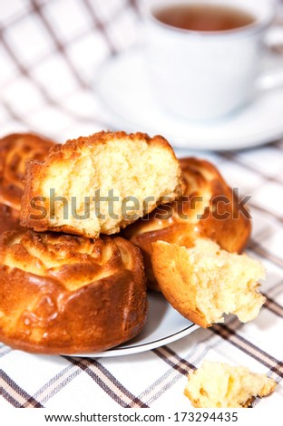 Rose shape cupcakes on the plate for the breakfast - stock photo