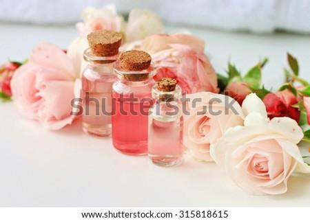 Rose spa setting aromatic water in bottles natural freshness soft delicate flowers feminine beauty - stock photo