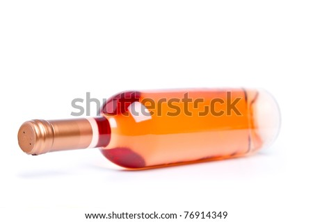 Rose wine in unmarked bottle (shallow DOF) - stock photo