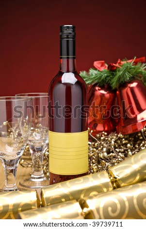 Rose wine on a decorated christmas table - stock photo