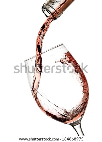 Rose wine pouring in a glass - stock photo