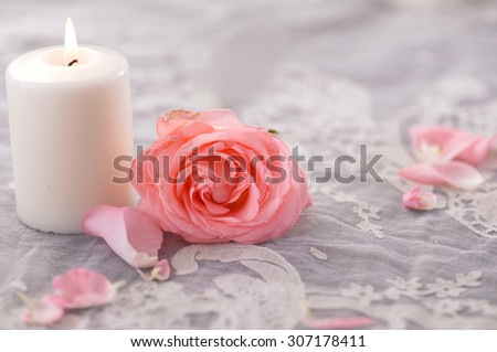Rose with candle on silk