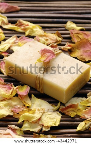 rose withered petals and soap - stock photo