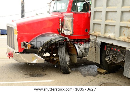 ROSEBURG, OR - JULY 20: A four vehicle accident involving two large trucks resulted in a single injury and a diesel fuel spill. July 20, 2012 in Roseburg Oregon