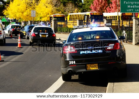 ROSEBURG, OR - OCTOBER 16: Police cars and school buses at an accident at the entrance of the High School loading zone in Roseburg Oregon, October 16, 2012 - stock photo