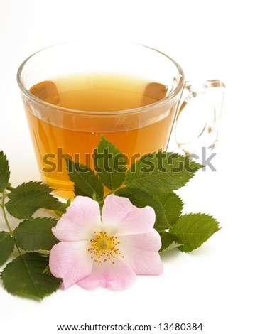 Rosehip tea and rosehip flower on white background