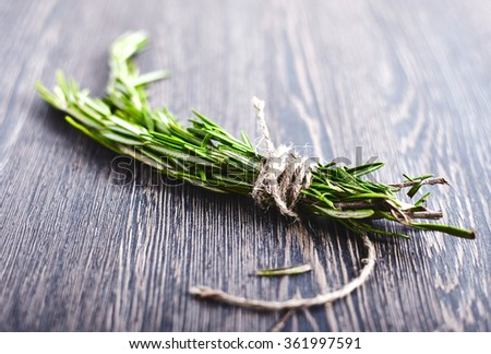 Rosemary bound on a wood - stock photo