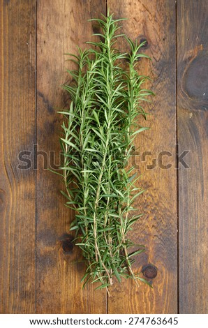 Rosemary bound on a wooden table - stock photo