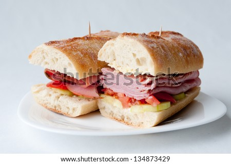 rosemary ham sandwich on baguette with fresh tomato and cucumber