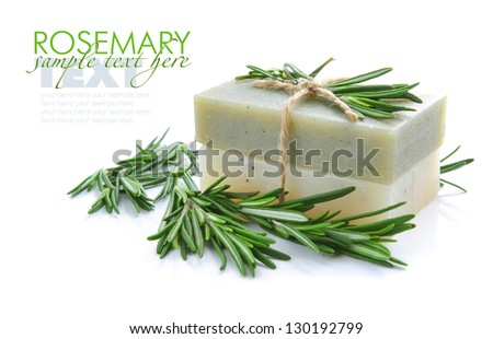 Rosemary Handmade Soap with the branches of rosemary on a white background - stock photo