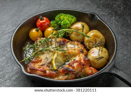 Rosemary herb firing of the chicken to make with an iron pan - stock photo