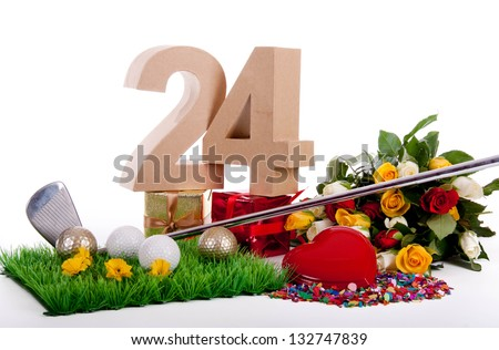 Roses, a golf club and golf balls on an artificial peace of grass to be used as a birthday card - stock photo