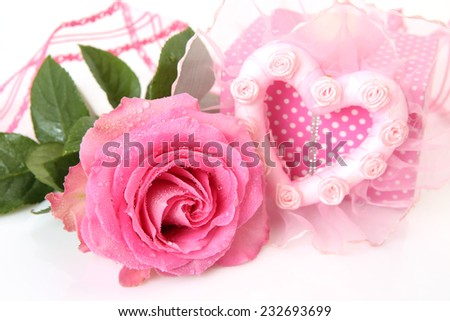 Roses and box with gift - stock photo