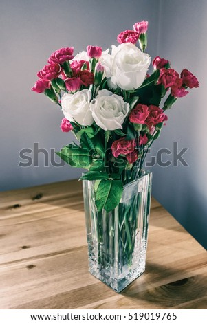 roses and cloves in glass vase