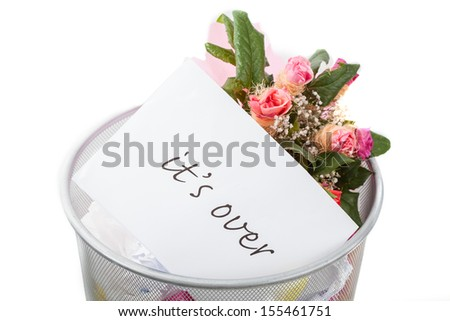 Roses and it's over note in dustbin, white isolated background - stock photo