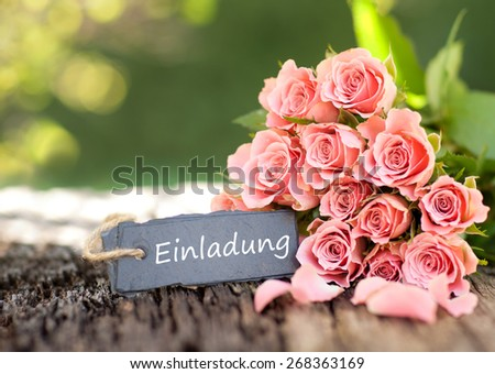 Roses and Label with german text: Invitation - stock photo
