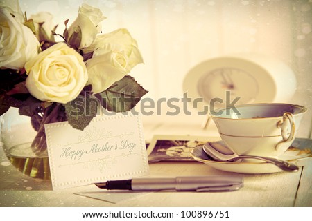 Roses and note card for Mother's day with vintage feel - stock photo