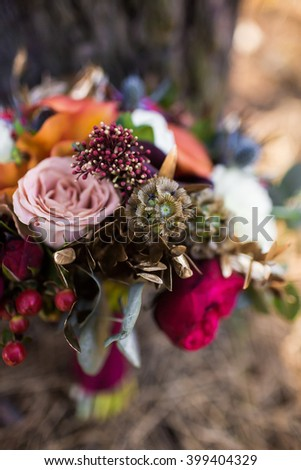 roses and other flowers inside marsala rustic wedding bouquet