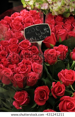 Roses at a flower stall at the market in Aix en Provence - stock photo