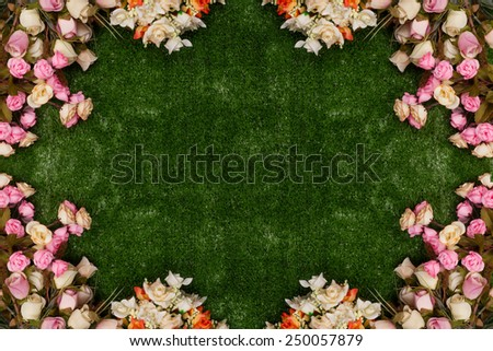 Roses bouquet frame on fake green grass background. - stock photo
