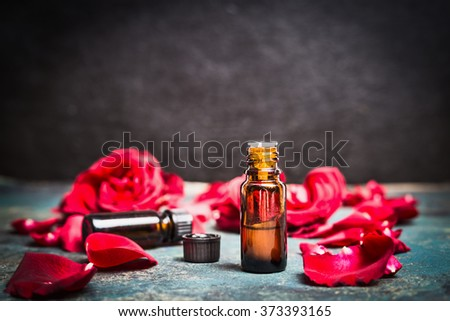 Roses essential oil for cosmetic products, aromatherapy treatment , spa or wellness. - stock photo