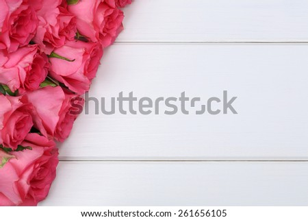 Roses flowers on Valentine's or mother's day on wooden board with copyspace for your own text - stock photo