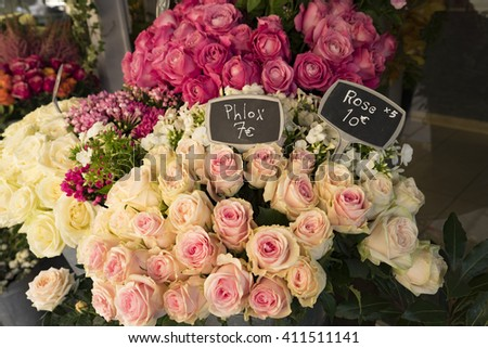 Roses for sale in Paris flower shop with labels displaying euros - stock photo