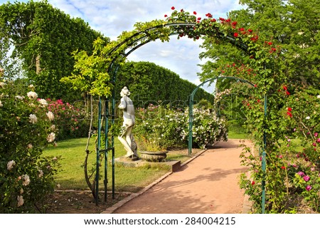 Roses garden in the Jardin de Plant in Paris, France. Eastern part of the garden with it's beautiful rose archways in May. - stock photo