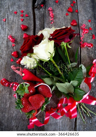 roses, hearts, ribbons and strawberry - stock photo