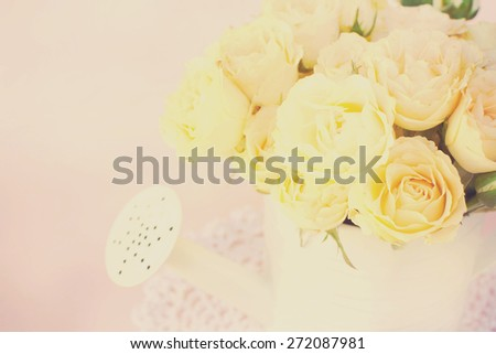Roses in a decorative watering can - stock photo