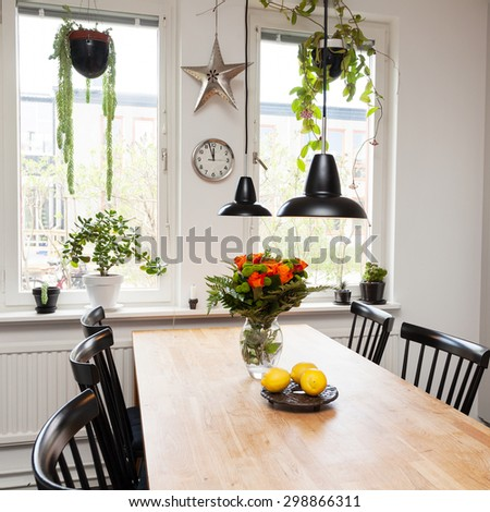roses in a vase on kitchen table - stock photo