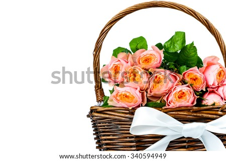 Roses in the wicker on white background - stock photo