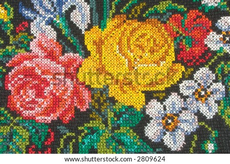 Roses on fabric (textile background) - stock photo