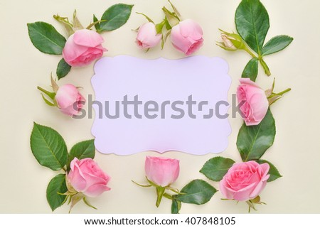 Roses on paper card - stock photo