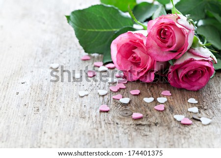 roses on wood with copy space  - stock photo