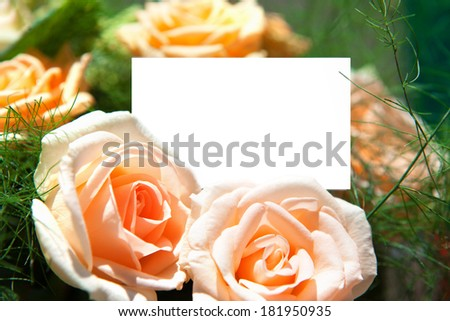 Roses with blank white card for your own note.