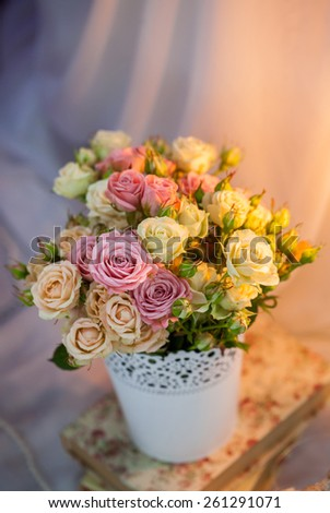 roses with candle on colorful background