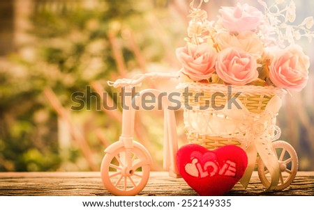 Roses with red heart in the basket.Bicycle on Vintage Retro Soft Background. - stock photo