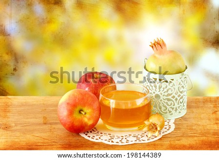 rosh hashanah concept - apple honey and pomegranate over wooden table.  - stock photo