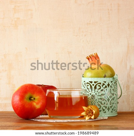rosh hashanah concept - apple honey and pomegranate over wooden table  - stock photo