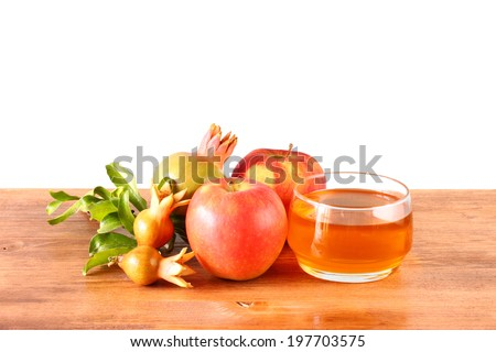 rosh hashanah concept - apple honey and pomegranate over wooden table. isolated. - stock photo