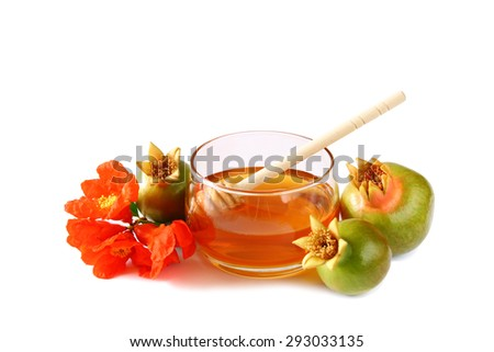 rosh hashanah (jewish holiday) concept - honey and pomegranate isolated on white. traditional holiday symbols.