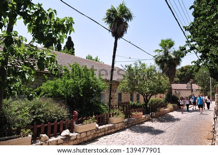 ROSH PINA,ISR - JUNE 21:Visitors at Rosh Pinna on June 06 2009.It was founded in 1882 by thirty families returning from the Jewish diaspora making it one of the oldest Zionist settlements in Israel. - stock photo