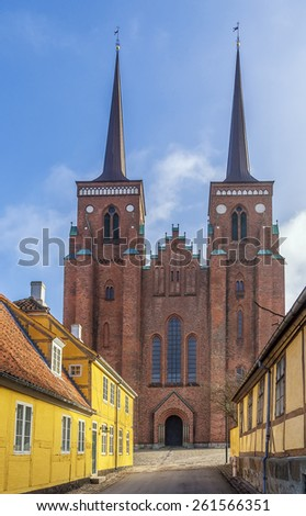 Roskilde Cathedral is a cathedral of the Lutheran Church of Denmark.  The first Gothic cathedral to be built of brick, it encouraged the spread of the Brick Gothic style throughout Northern Europe. - stock photo