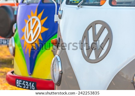 ROSMALEN, THE NETHERLANDS - JANUARY 4, 2015: Row of colorful Volkswagen Transporter type 2 vans from the seventies in Rosmalen, The Netherlands - stock photo