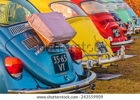 ROSMALEN, THE NETHERLANDS - JANUARY 4, 2015: Row of vintage Volkswagen Beetles from the seventies in Rosmalen, The Netherlands - stock photo